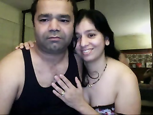 Cute Indian babe sucking her partners cock licking his balls during foreplay while he pumps his dick