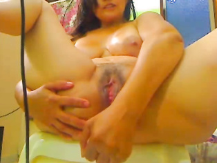 Big boob Indian bimbo from Malaysia exposing her juicy assets to her man in India on a webcam.