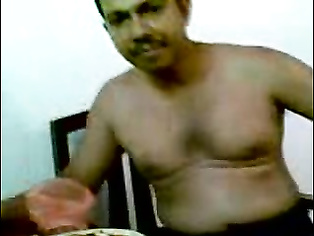 Married Srilankan couple enjoy foreplay session while drinking with their friends.