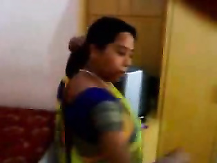 Bhabhi changing her blouse and peticot in bedroom which hubby is filming her and asking her to give some sexy poses.