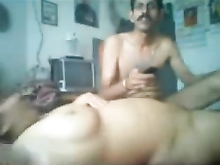 Mature Indian wife getting her big boobs sucked by husband showing big round ass cheeks while giving him head during oral sex foreplay.