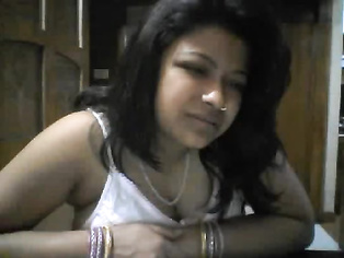 Mature Indian divorced housewife Jaya stripping naked exposing herself off on live webcam from her bedroom.