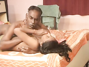 Mature men playing with her young girlfriend watching a porn film on tele and sucking her juicy tits.