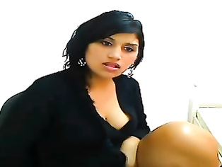 NRI hottie Roshnie in stockings and garter belt showing big boobs ass cheeks and fingering pussy to masturbate on cam in this awesome video.