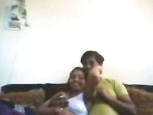 Indian college couple Deepti and Tinku enjoying foreplay session in lounge recorded on cam.