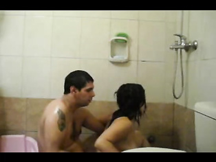 Horny couple in shower trying sex and wife moaning loudly every time the guy inserts his dick into her vagina and squeezes her tits in this MMS.
