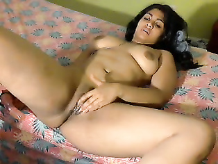 Super sexy Indian babe Rupa masturbating with a big dildo penetrating deep inside to hit his womb and moaning heavily in pleasure and orgasm.