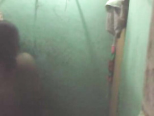 Telugu bhabhi in shower opening her blouse getting naked for shower recorded by hidden cam fixed in her toilet by neighour.