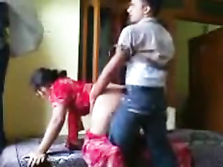 Naughty Indian bhabhi stripping off her dress one by one while kissing her man aka chumma chaati and he fondles her tits and sucks them.