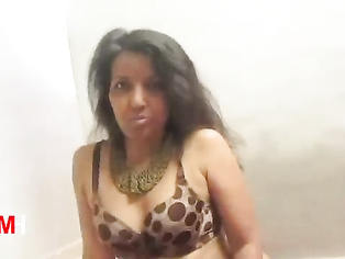 B-grade indian model Kalpana erotic photo session in sexy outfits in a studio.