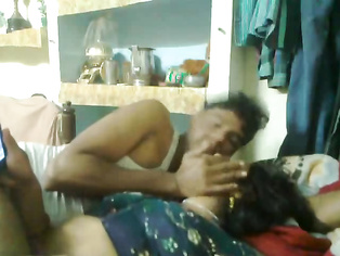 Mumbai raand after sex with her pimp laying watching a porn movie on his mobile who is playing with her boobs.