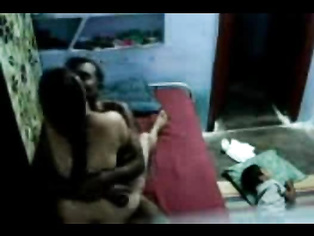 Married Telugu couple in their bedroom, hubby fixing camera to record their sex while every body in bedroom sleeping.