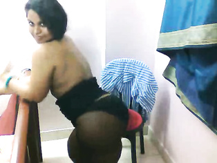 Busty desi babe Lilly in blue shirt and in stockings doing a self recorded strip show leaked online!.