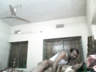 Desi couple from Meherpur showing big boobs while getting her tight clean shaven cunt fucked by horny husband in missionary position in this MMS.