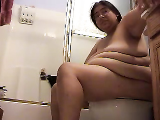 Big boobs Indian milf in toilet after freshing up fingering her pussy while sitting on a toilet seat!.