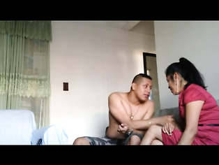 Mizoram guy call cal girl in her apartment relaxing with her in lounge playing with her tits and cums inside and then they both lie next to each other caressing and talking during after play.