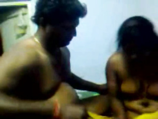 Shy south Indian desi aunty moaning in pleasure while getting fucked hard missionary style wrapping her legs around the mans waist caught on hidden cam video.