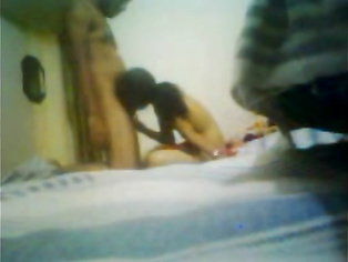 Desi girl and boy in hotel room and the guy hikes the top of the babe to expose and suck her tits before fucking her missionary style and cumming inside her and then cleaning her pussy while their friend shoots this awesome MMS.