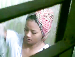 Bangladeshi college babe Deepa Magi in shower filmed by her cousin visiting them using his mobile cam from bathroom roof!. video2porn2