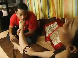 Young sexy Indian wife Riya with her husband Rockey getting her feet worship, washing with champagne licking it off and sucking her toes!.