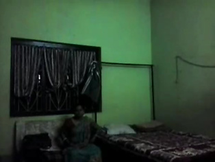 Classic homemade fucking on an Indian couple in their bedroom wife spreading her legs wide while her man pumpinp her pussy in traditional missionary style position.