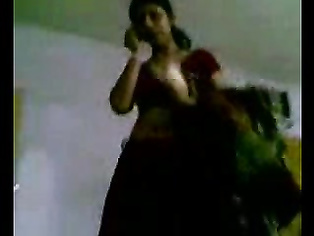 Bangladeshi housewife lying on her stomach and her hubby caressing her big round ass cheeks and playing her boobs and nipples during foreplay and fucked in missionary position.