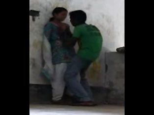 Patna, Bihar high school girl in coaching center roof after class with her boyfriend who passionately kissed her and pressing her juicy boob!.