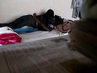 Naughty Indian college students girl kissing her boyfriend and then sucking his dick to give him a blowjob while he plays with her lovely tits during sex foreplay.