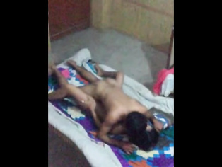 Pakistani married young girl lying naked in bed showing lovely tits and clean shaven pussy getting caressed by horny husband before fucking session in this MMS.
