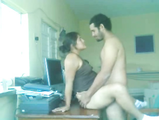 Nawaz and Hira make out on a computer table for a bit as he removes her top and licks her big brown nipples, then she pulls off his pants so she can get at Nawaz's huge cock.