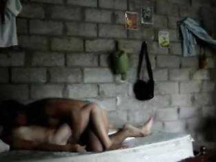Sexy dusky Indian village bhabhi getting fucked by horny hubby with bra hiked up and tits exposed covering her face getting cum load inside running to the bathroom to clean up showing her ass cheeks also while dress up in this must watch MMS.