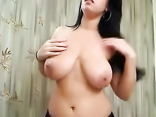 Indian girl with immense boobs plays with dildo.