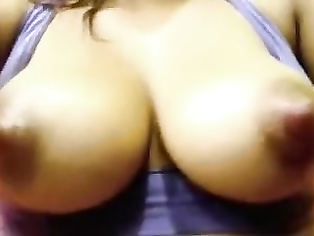 Juicy tits Amita squeezing her nipples for milk.