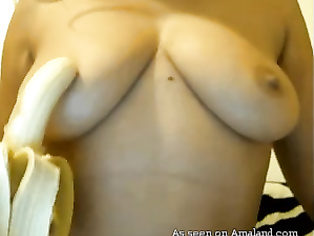 Naughty Indian babe sucking a banana on camera.