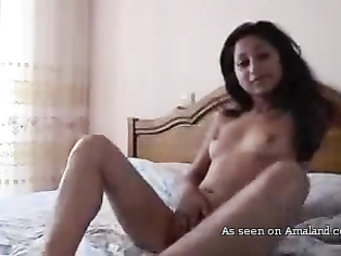 Sexy Desi girl teasing on the bed.