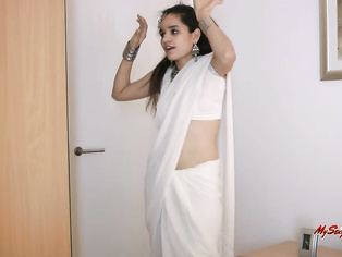 Jasmine lets you know she's here to tease you in her sexy traditional Indian sari.