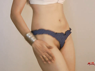 as her trimmed pussy in visible through the panties as she lightly pumps her fist onto her crotch.