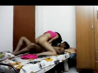 Young sexy couple having sex in their bedroom.