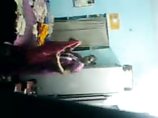 Raghava Telugu aunty changing her clothes in her room.
