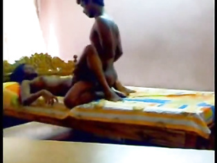 Hot South Indian couple enjoying sex in their bedroom.