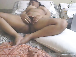 Desi housewife Kinjal in her bedroom with webcam on fucking herself off with big dildo.