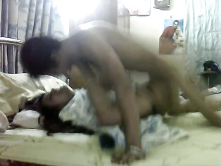 Bangladeshi girlfriend Laboni with her partner naked in bed engaged in foreplay session before she gets fucked.