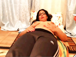 Mature bengali bhabhi doing a cam show from Dhaka sitting naked playing with her milk juggs in a private cam show.
