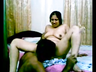 Indian village bhabhi stripped naked by her husband who hikes her black bra to suck her tits and pulls down panty to expose her ass cheeks before starting to fuck her missionary style.