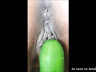 Kinky Indian slut gets fucked with a cucumber.
