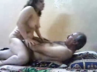 Dubai based mature pakistani couple in bedroom.